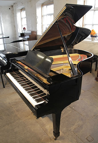 A 1975, Yamaha G3 grand piano for sale with a black case and spade legs