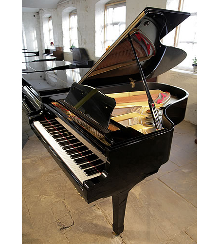 A 1975, Yamaha G5 grand piano for sale with a black case and spade legs