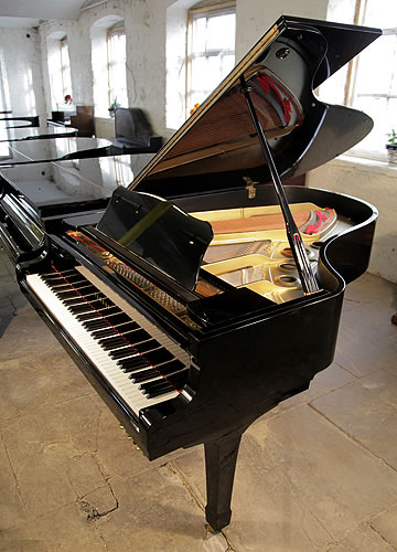 A 1975, Yamaha G5 grand piano for sale with a black case and spade legs. Piano hass eighty-eight notes and three pedals