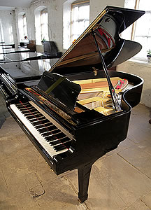 A Yamaha G5 grand piano for sale with a black case and polyester finish.