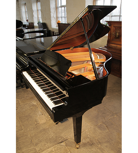 A 2003, Yamaha GA1 baby grand piano for sale with a black case and tapered, square legs