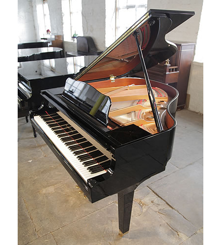 A 1978, Yamaha GB1 baby grand piano for sale with a black case
