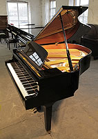 A 1988, Yamaha GH1 grand piano with a black case