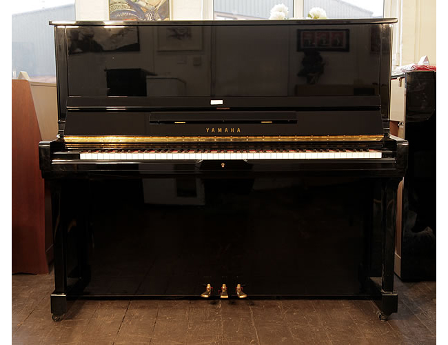 A 1991, Yamaha SU-131 upright piano with a black case and polyester finish
