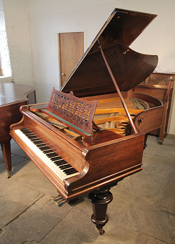 An 1896, Bechstein Model B grand piano with a polished, rosewood case and turned legs