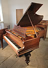Piano for sale. A  Bechstein Model B grand piano with a polished, rosewood case and turned legs