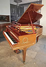 Piano for sale. A 1914, Bluthner Grand Piano For Sale with a Walnut Case and Open Work Music Desk. Cabinet Features Ormolu Decoration of Laurel Wreaths on Piano Cheeks