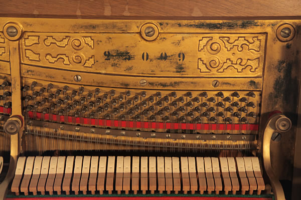 Ludwig Adam Upright Piano For Sale With An Ornately Carved