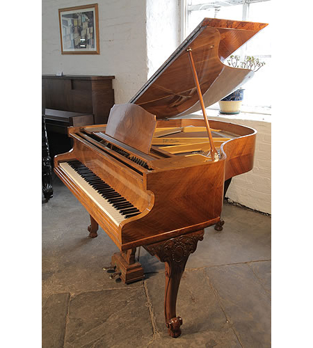 An 1933, Monington and Weston Baby Grand Piano with a Quartered, Walnut Case and Cabriole Legs.