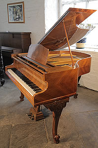 A 1933, Monington and Weston baby grand piano with an exquisite, quartered, walnut case. Cabinet features scroll foot, cabriole legs.