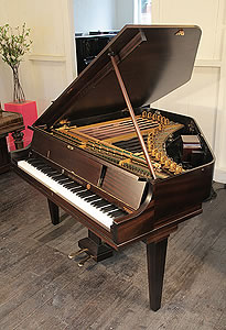 A Neo-Bechstein electric grand piano with a mahogany case. The first electric grand piano