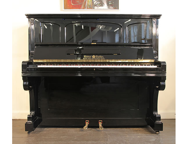 A 1903, Ritter Halle upright piano with a black case
