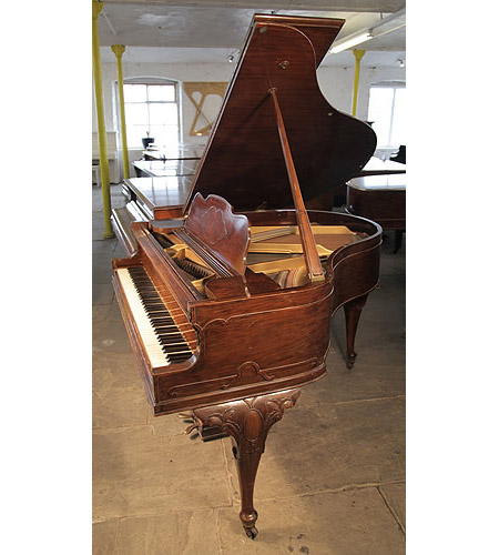 An 1899, Queen Anne style Steck baby grand piano with a walnut case. Cabinet features carved, cabriole legs