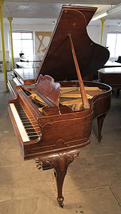 An 1899, Queen Anne style Steck baby grand piano with a walnut case. Cabinet features carved, cabriole legs.