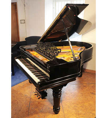A 1900, Steinway Model A grand piano with a black case and turned, fluted legs