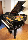 Piano for sale. A  1900, Steinway Model A grand piano with a black case.