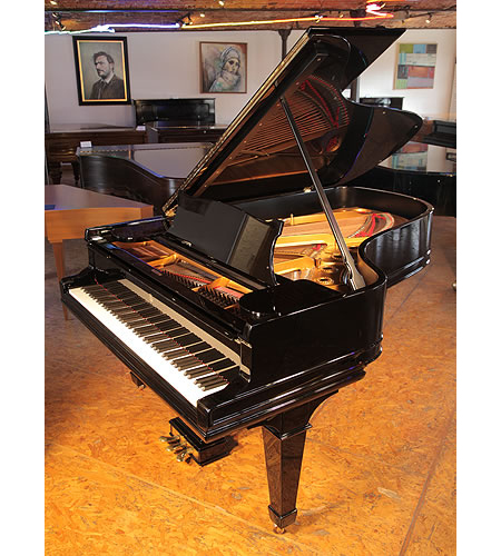 A 1904, Steinway Model B grand piano with a black case and spade legs