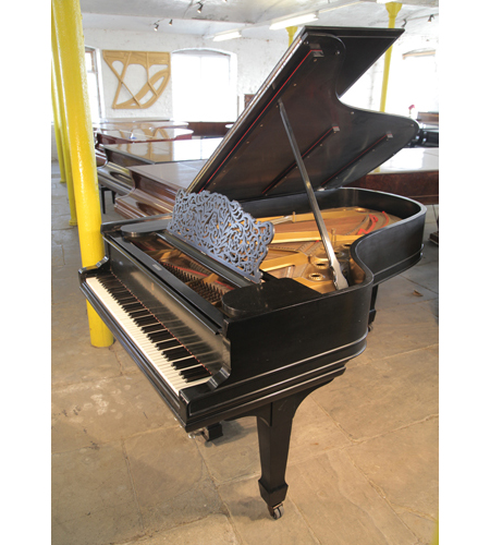 An 1896, Steinway Model B grand piano with a black case and spade legs