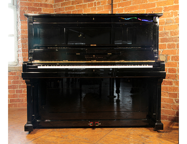 A restored, 1891, Steinway Model K upright piano with a black case