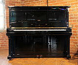 Piano for sale. A preowned, 1891, Steinway model K upright piano with a  black case