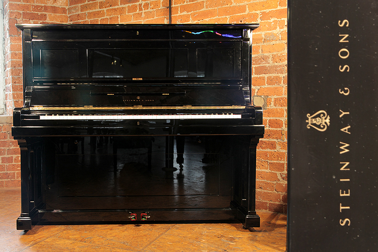 An 1891, Steinway Model K upright piano with a black case