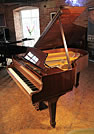 A 1970, Steinway Model M grand piano with a mahogany case and spade legs