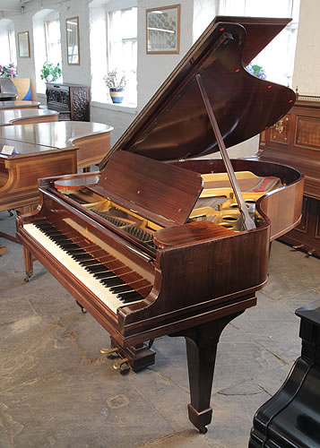 An unrestored,, 1913, Steinway Model O grand piano with a b rosewood case and spade legs.