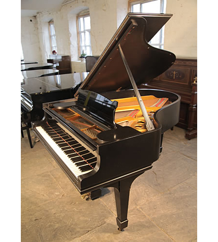An unrestored, 1901, Steinway Model O grand piano with a black case and spade legs