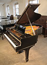 Piano for sale. A  Steinway Model O grand piano with a black case
