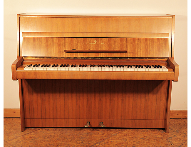 A 1970, Steinway Model Z upright piano with a mahogany case
