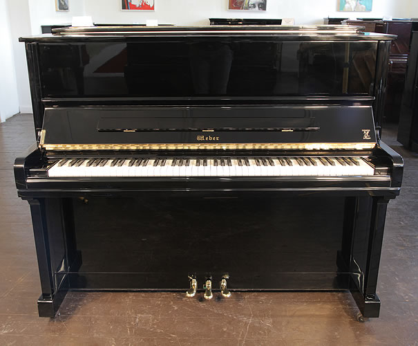 An ex-display, Weber W-121 upright piano with a black case and brass fittings.
