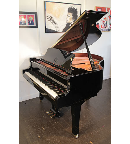 An ex-display, Weber W150 baby grand piano with a black case and soft fall keyboard mechanism