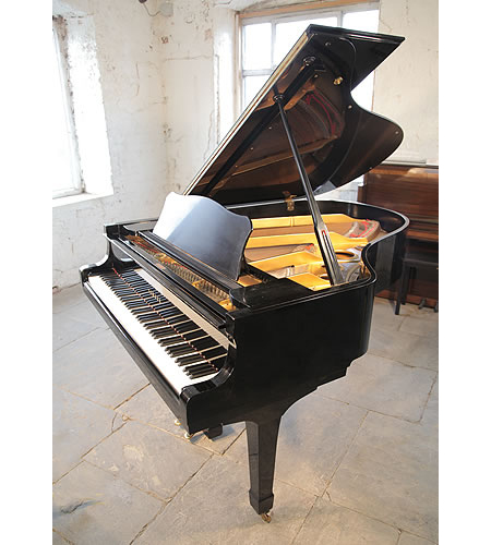 A 1973, Yamaha C3 grand piano with a black case and spade legs
