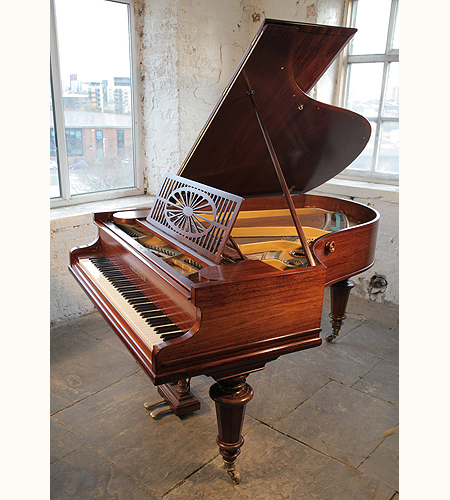 An antique, 1904,Bechstein Model A grand piano with a polished, rosewood case and turned legs. Piano has an eighty-five note keyboard and a two-pedal lyre.
