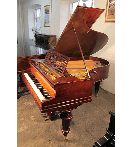 A restored, Bechstein Model A grand piano with a polished, rosewood case and turned legs