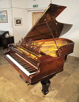 An Antique, Bechstein Model D grand piano with a polished, rosewood case, filigree music desk and turned legs. Piano Has a fitted PianoDisc Symphony Pro 228 CFX system.