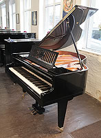 A 1936, Bosendorfer baby grand piano for sale with a black case, slatted music desk and square, tapered legs