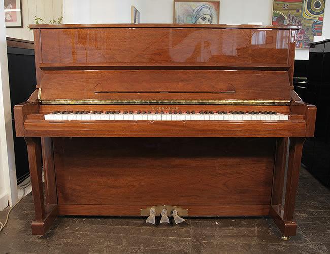 A brand new, Eisenstein UP121 upright piano with a walnut case and polyester finish