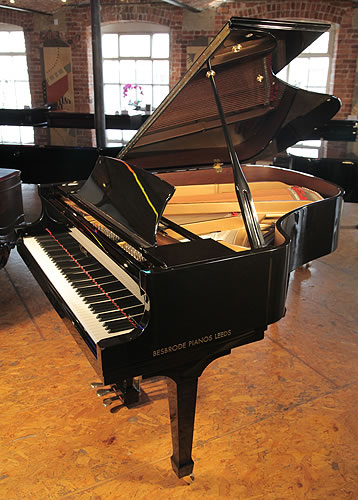 A pre-owned, 2008, Essex EGP173 grand piano with a black case and polyester finish.  Designed by Steinway and Sons.