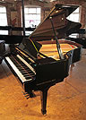 Piano for sale. A pre-owned, 2008, Essex EGP173 grand piano with a black case and polyester finish.