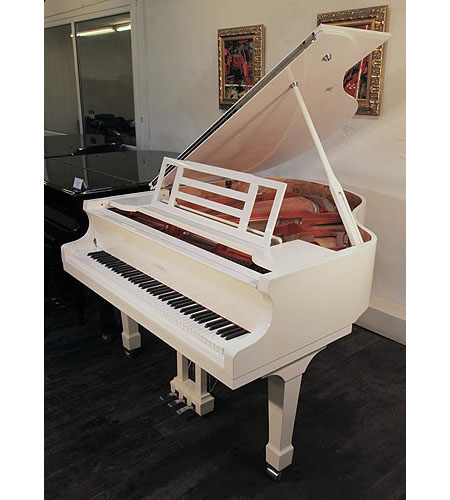 A brand new, Feurich Model 161 Professional grand piano with a white case and chrome fittings.