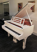 A brand new, Feurich Model 161 Professional grand piano with a white case and chrome fittings