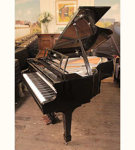 A brand new, Feurich Model 178 Professional grand piano with a black case, gun metal frame and chrome fittings.