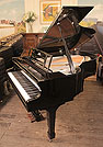 Piano for sale. A brand new, Feurich Model 178 Professional grand piano with a black case, gun metal frame and chrome fittings.