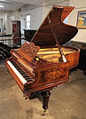 Piano for sale. A Gebruder Knake grand piano with a beautifully, inlaid rosewood case