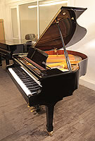 A 2007, Halle and Voight WG160 baby  grand piano for sale with a black case