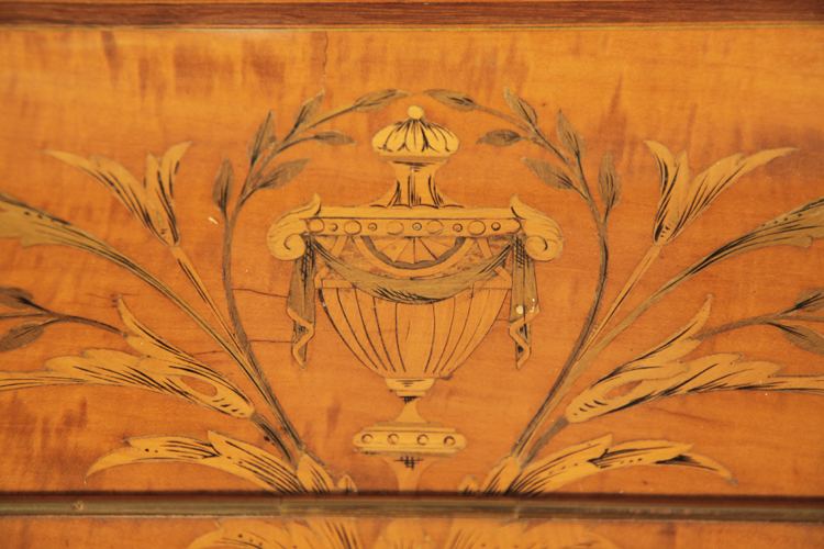 Hopkinson inlaid piano fall featuring a swagged urn surrounded by laurel and acanthus