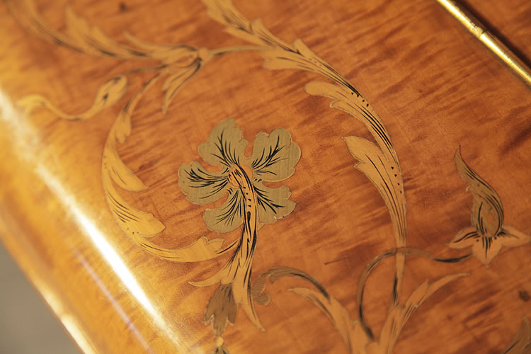 Inlaid hibiscus detail.