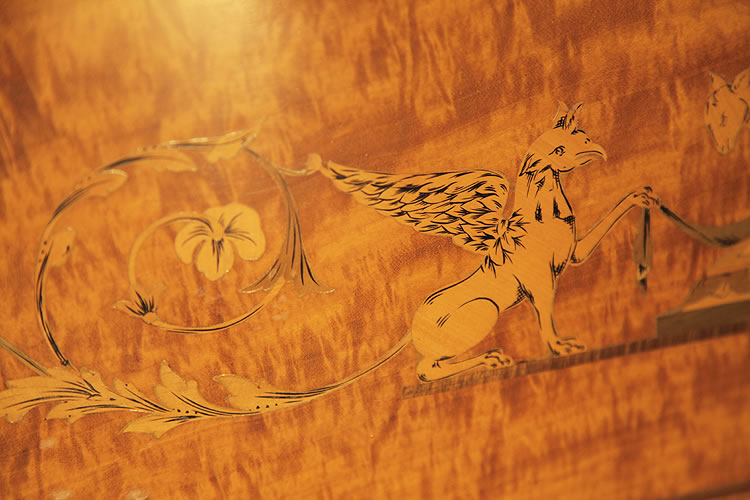 Inlaid griffin with hibiscus and acanthus scrolls