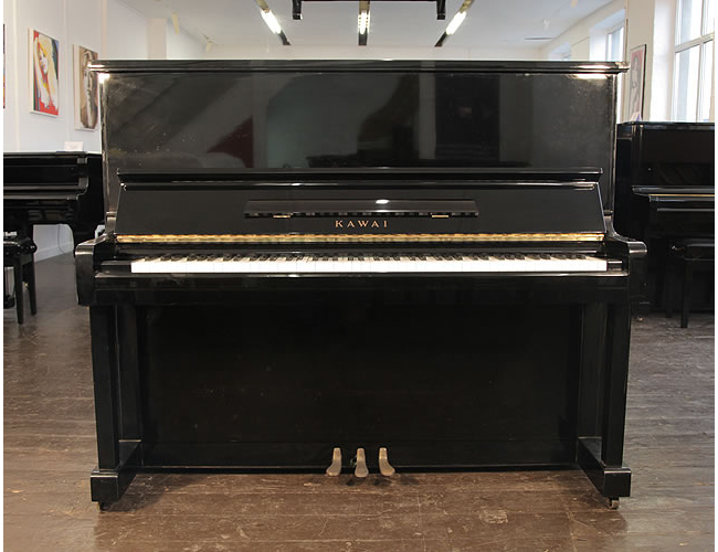 A 1976, Kawai BL-12 upright piano with a black case and polyester finish